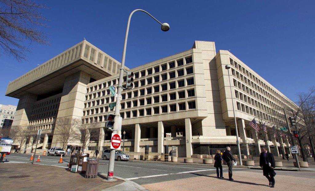 FILE - This Feb. 3, 2012, file photo shows FBI headquarters in Washington. Many U.S. diplomatic, military and government figures were not told about R...