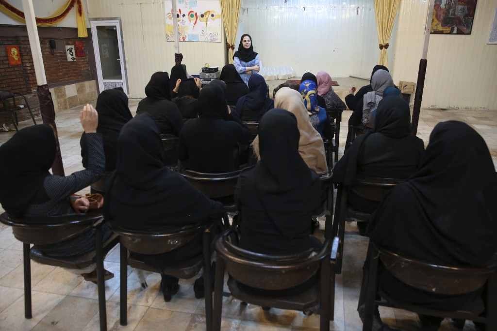 In this Wednesday, Sept. 27, 2017 photo, psychologist Najimeh Babagol speaks in a class with HIV-positive women at Reviving Values aid group institute...