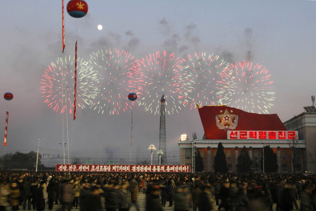 In this Friday, Dec. 1, 2017, file photo, fireworks explode above the Taedong river as people gather at Kim Il Sung Square for a rally in Pyongyang, N