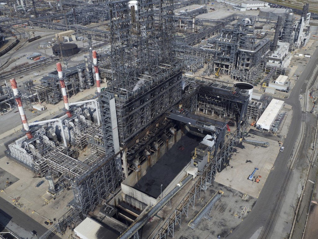 In this Sept. 21, 2017 photo, petroleum coke, the grainy black byproduct of refining Canadian tar sands oil, is visible at the BP Whiting refinery in ...