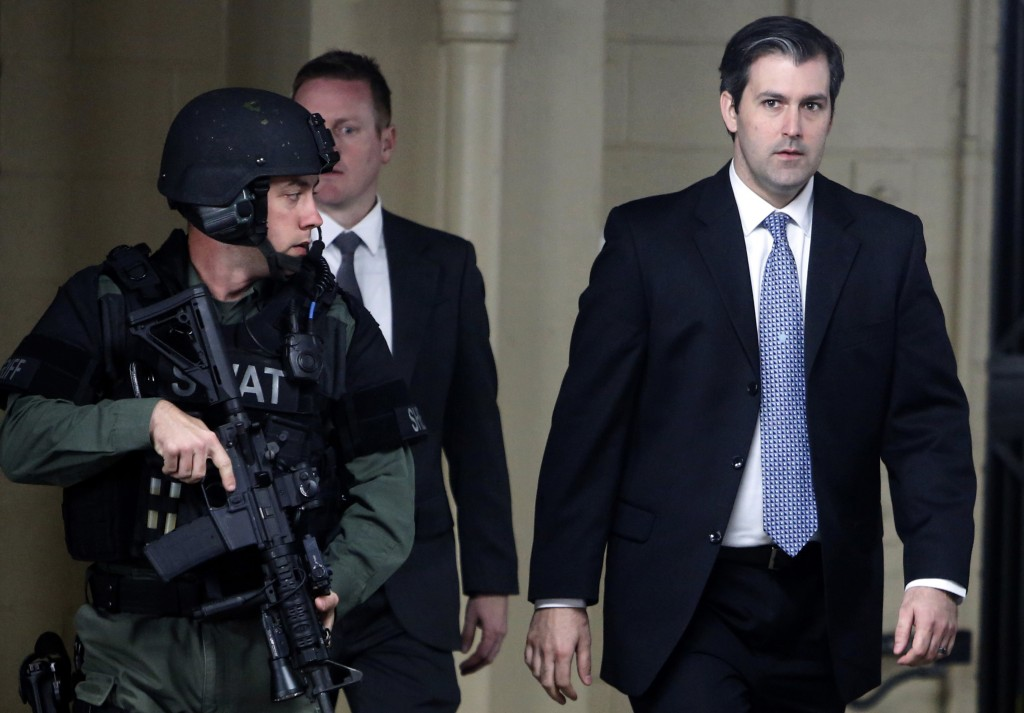 FILE - In this Monday, Dec. 5, 2016, file photo, former South Carolina police officer Michael Slager, right, walks from the Charleston County Courthou