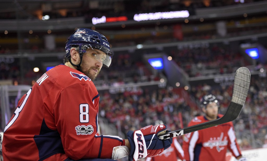 Washington Capitals left wing Alex Ovechkin (8), of Russia, looks on during a break in the action in the first period of an NHL hockey game against th