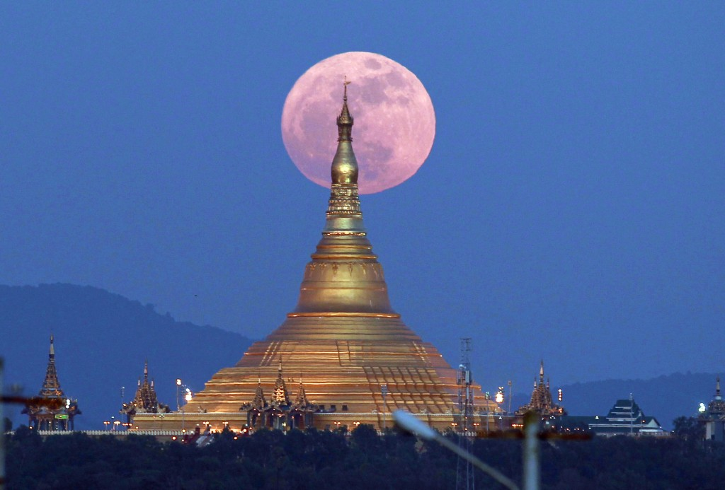 In this Sunday, Dec. 3, 2017, file photo, the moon rises behind the Uppatasanti Pagoda seen in Naypyitaw, Myanmar. The Dec. 3 full moon is the first o