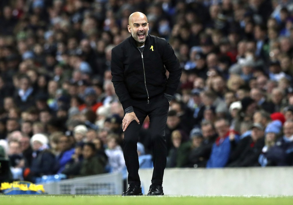 Manchester City manager Pep Guardiola gestures on the touchline during the English Premier League soccer match against West Ham United at the Etihad S