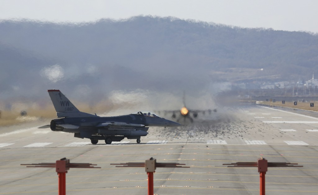 In this Monday, Dec. 4, 2017, file photo, U.S. Air Force F-16 fighter jet prepares to take off at Osan U.S. Air Base in Pyeongtaek, South Korea. Hundr