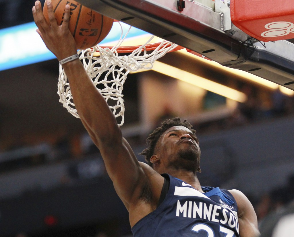 Minnesota Timberwolves guard forward Jimmy Butler (23) shoots against the Los Angeles Clippers in the first quarter of an NBA basketball game on Sunda...