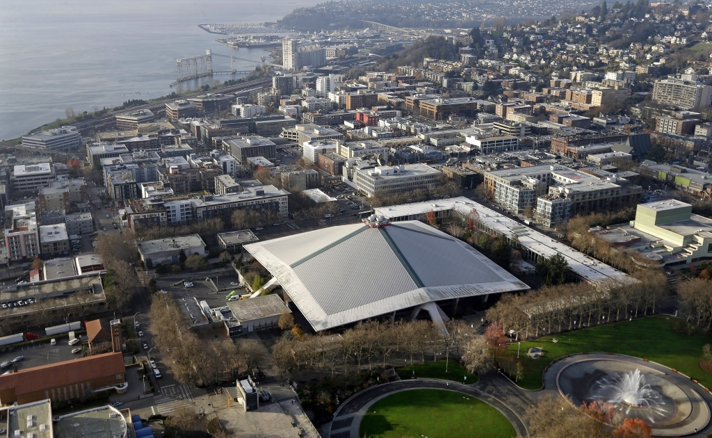 The iconic sloped roof of KeyArena, center, a sports and entertainment venue at the Seattle Center, is seen from above Monday, Dec. 4, 2017, in Seattl