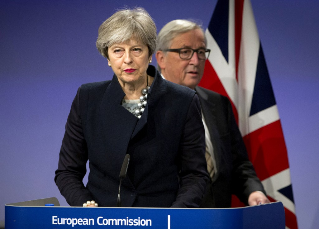 European Commission President Jean-Claude Juncker, right, walks behind British Prime Minister Theresa May prior to addressing a media conference at EU