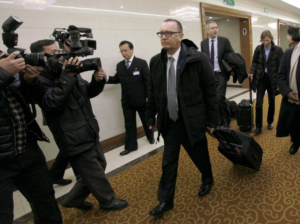 U.N. Undersecretary-General for Political Affairs Jeffrey Feltman, center, walks upon arrival at the Pyongyang International Airport in Pyongyang, Nor