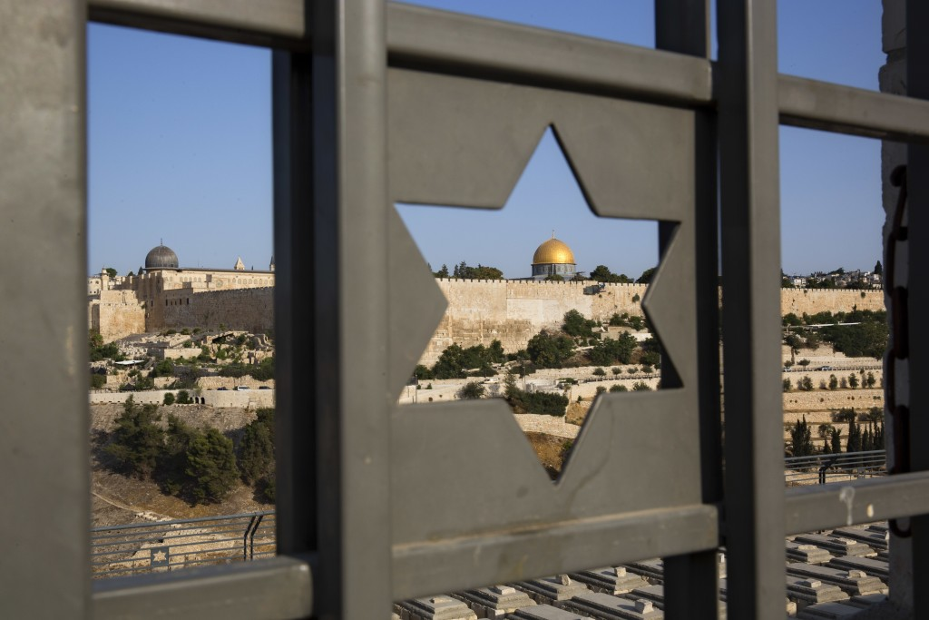 FILE - In this July 25, 2017 file photo, Jerusalem's Old City is seen trough a door with the shape of star of David. Turkey and the Palestinians have
