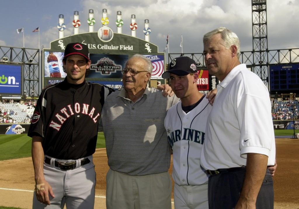 In this  July 15, 2003  file photo, then-Cincinnati Reds' Aaron Boone, left, and his brother, Bret, second from right, pose with their grandfather, Ra