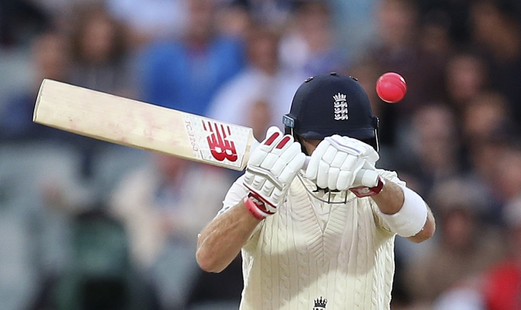 In this Tuesday, Dec. 5, 2017, file photo, England's Joe Root swings at a high delivery from Australia's Pat Cummins during the fourth day of their As
