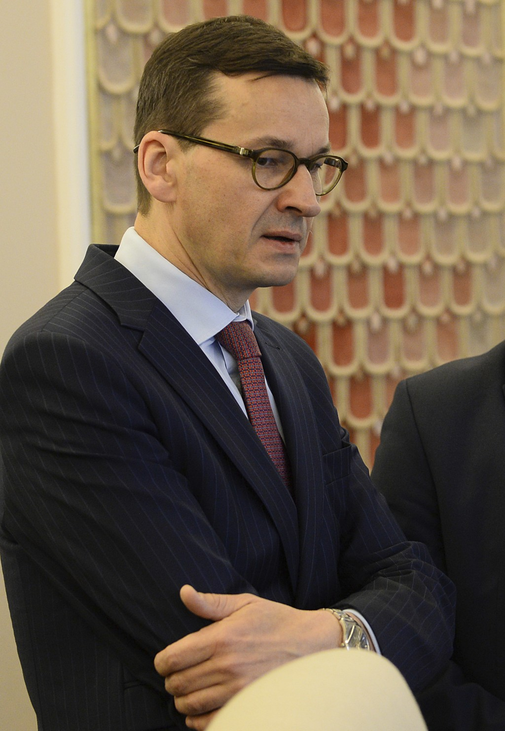 Poland's Finance Minister Mateusz Morawiecki waits for the start of a government meeting in Warsaw, Poland, Tuesday, Dec. 5, 2017. Poland's Prime Mini
