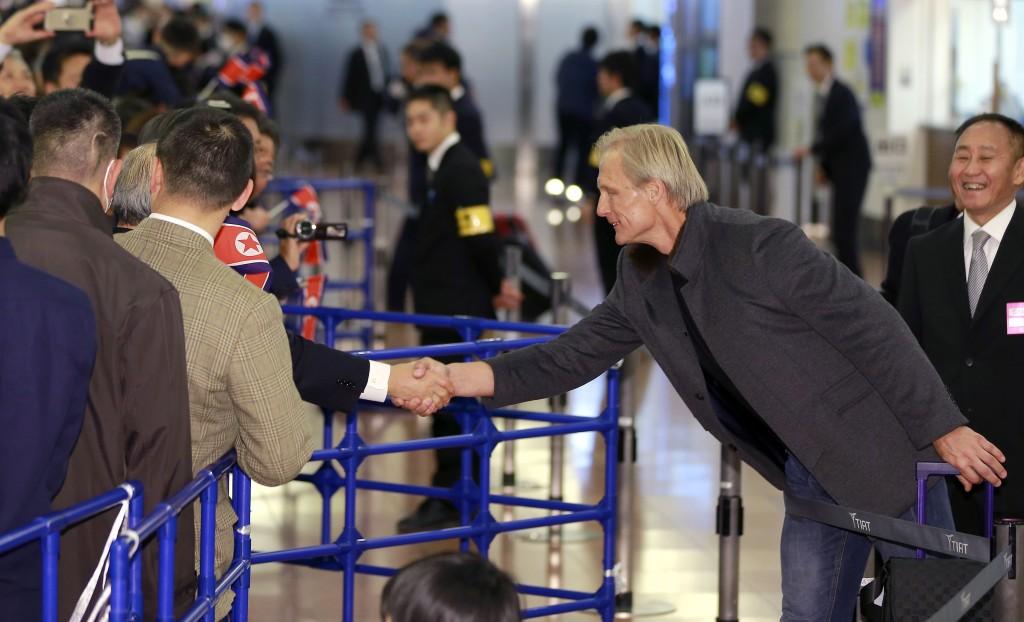 North Korean men's national soccer team head coach Jorn Andersen of Norway is greets by North Korea residents in Japan upon arrival at Haneda internat