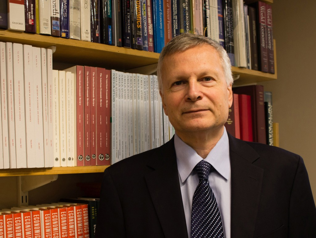 This Sept. 15, 2016, photo provided by Jessica De Simone shows author Dani Rodrik at his office at the Harvard Kennedy School in Cambridge, Mass. In R