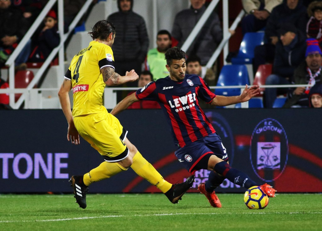 Crotone's Andrea Nalini, right, and Udinese's Gabriele Angella vie for the ball during the Italian Serie A soccer match between Crotone and Udinese at