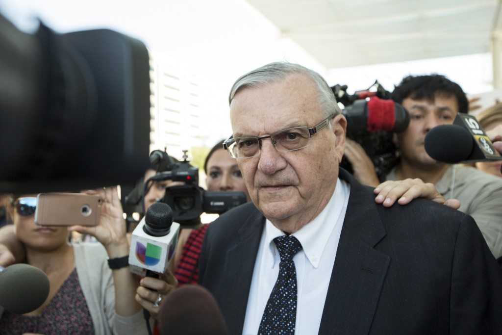 FILE- In this July 6, 2017, file photo, former Sheriff Joe Arpaio leaves the federal courthouse in Phoenix, Ariz. A trial is scheduled to begin Tuesda