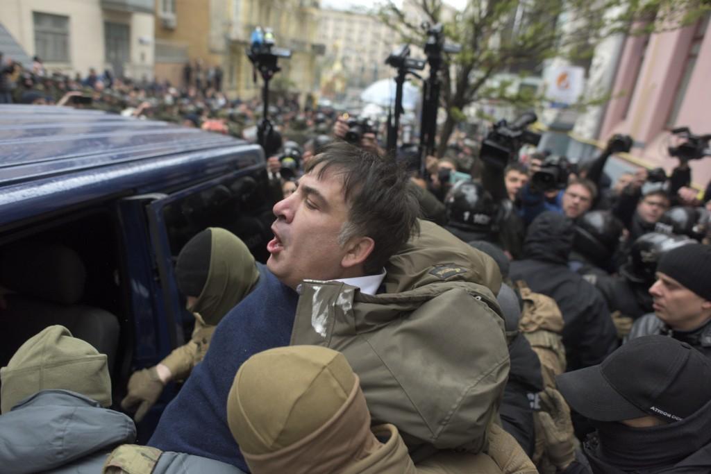 Ukrainian Security Service officers detain Mikheil Saakashvili at his house in Kiev, Ukraine, Tuesday, Dec. 5, 2017. Ukraine's intelligence agency on