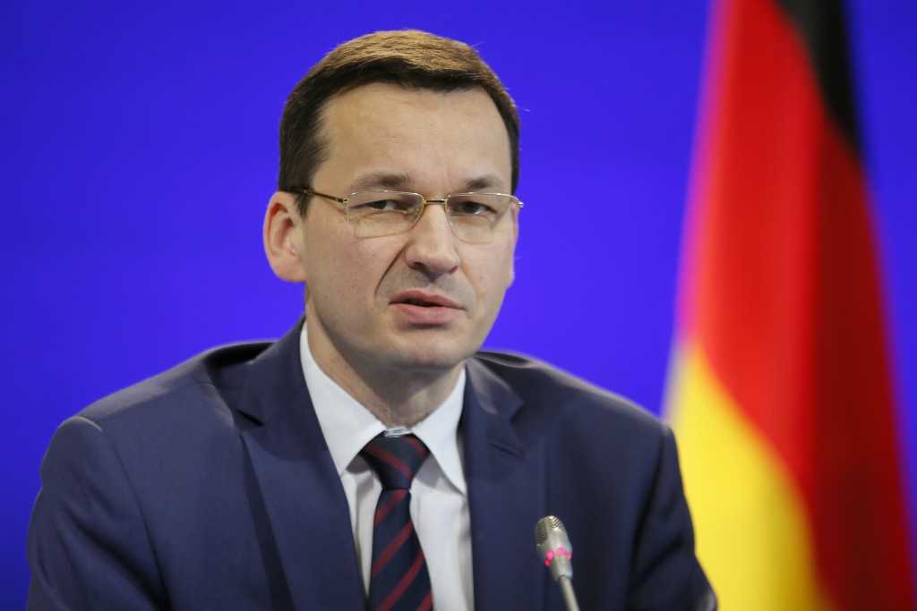 FILE - In this Feb. 22, 2017 file photo Poland's Finance minister Mateusz Morawiecki attends a joint press conference with France's Finance Minister M