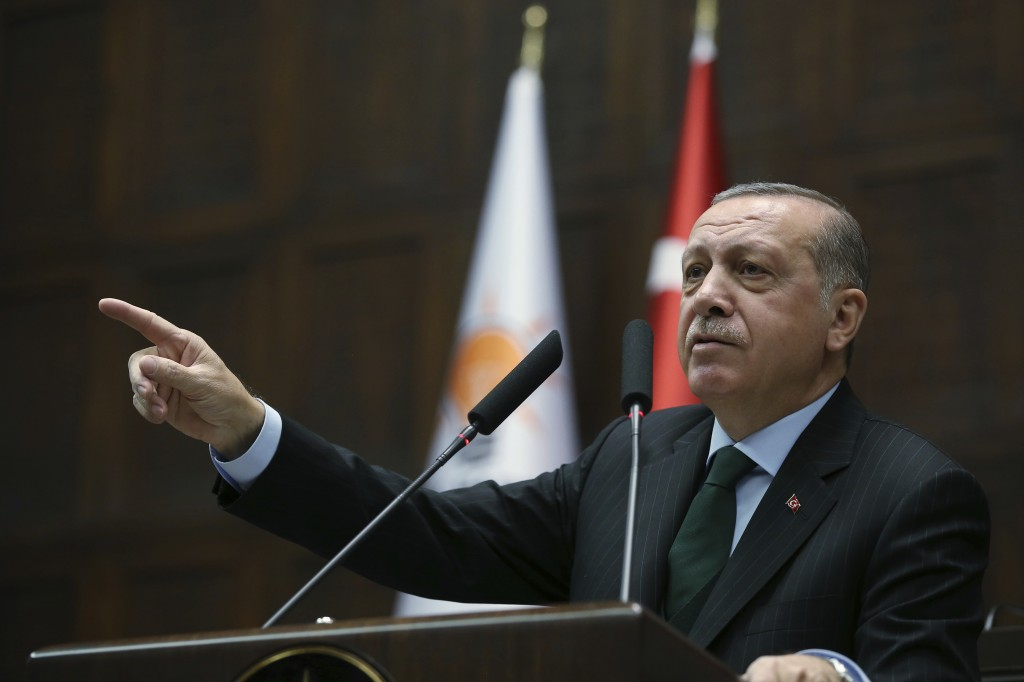 Turkey's President Recep Tayyip Erdogan gestures as he delivers a speech during a meeting of his ruling Justice and Development Party (AKP), in Ankara