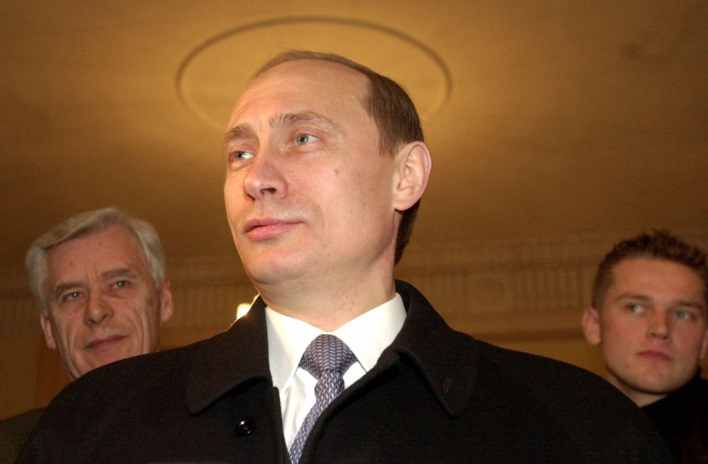 FILE - In this file photo taken on Sunday, March 26, 2000, acting Russian President and Presidential candidate Vladimir Putin talks with representativ