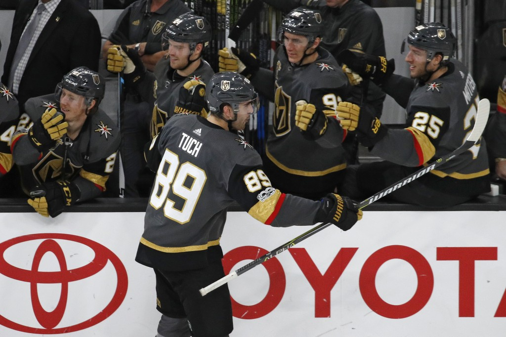 Vegas Golden Knights right wing Alex Tuch celebrates after scoring against the Anaheim Ducks during the shootout in an NHL hockey game Tuesday, Dec. 5