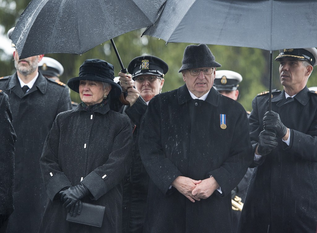 Nova Scotia Lt. Gov. Arthur Leblanc, right, and his wife Rosemarie Patricia LeBlanc brave the elements at a ceremony to mark the 100th anniversary of