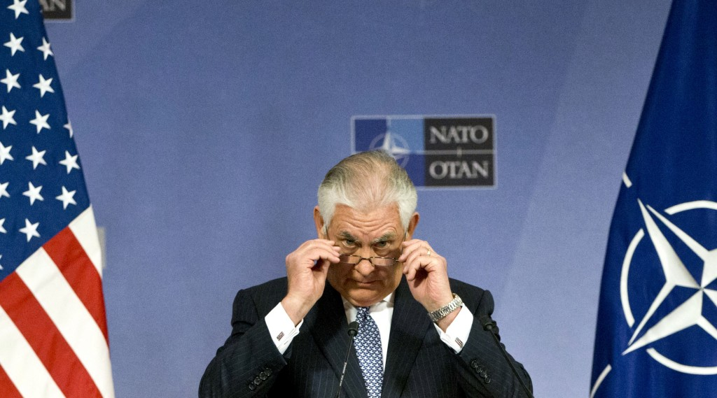U.S. Secretary of State Rex Tillerson adjusts his glasses as he speaks during a media conference at NATO headquarters in Brussels on Wednesday, Dec. 6