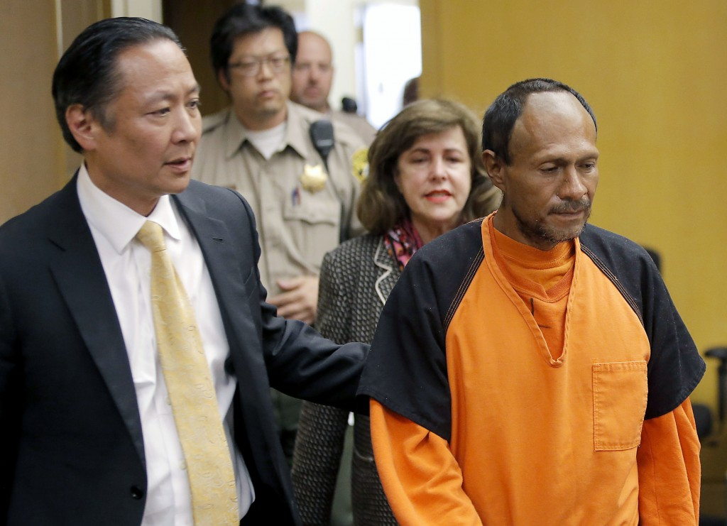 FILE - In this July 7, 2015 file photo, Jose Ines Garcia Zarate, right, is led into the courtroom by San Francisco Public Defender Jeff Adachi, left,