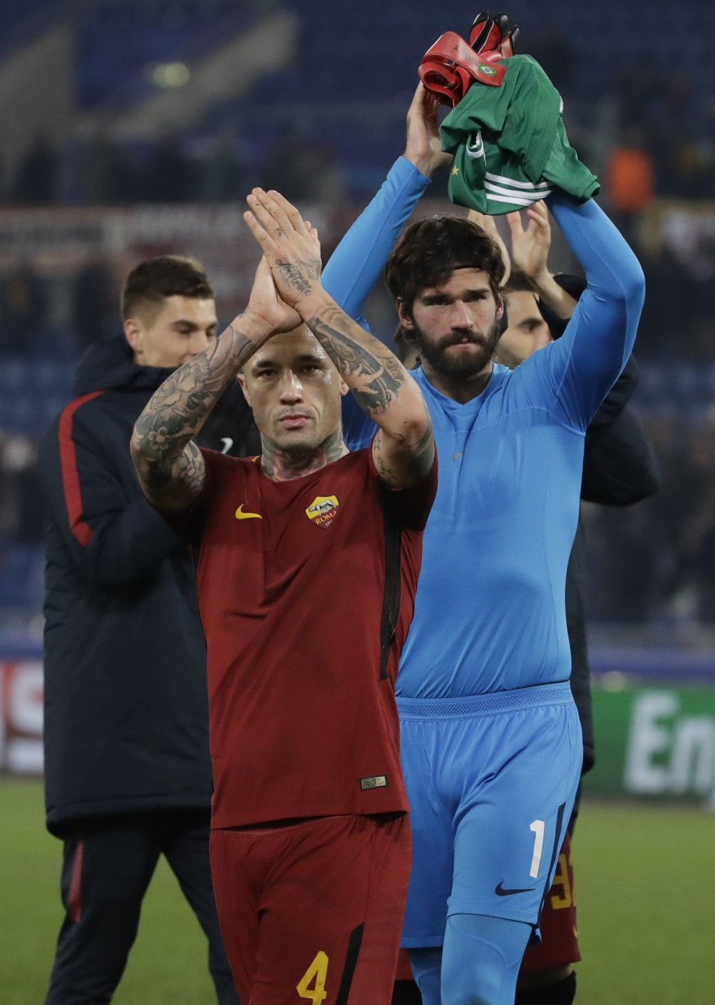 Roma goalkeeper Alisson, right and Roma's Radja Nainggolan celebrate their victory at the end of the group C Champions League soccer match between Rom