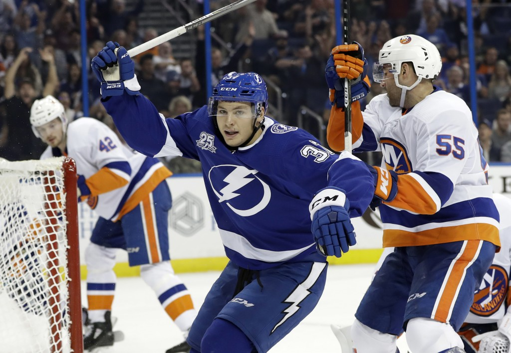 Tampa Bay Lightning center Yanni Gourde (37) celebrates after scoring against the New York Islanders during the second period of an NHL hockey game Tu