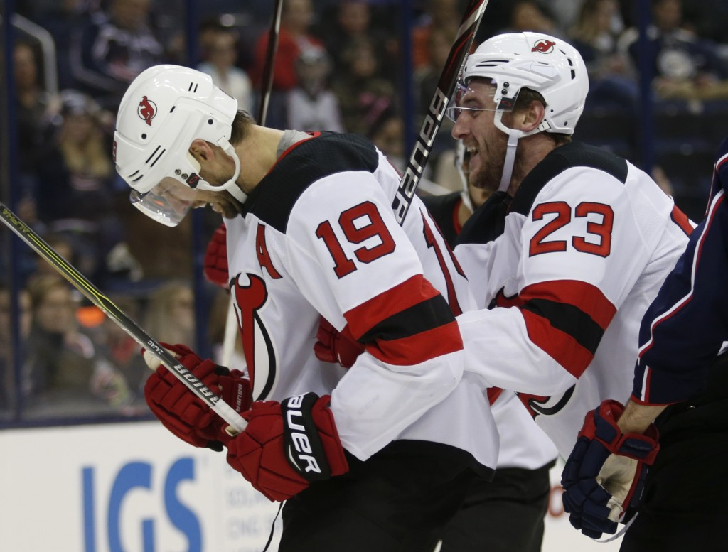 New Jersey Devils forward Travis Zajac, left, and teammate forward Stefan Noesen celebrate Zajac's goal against the Columbus Blue Jackets during the f
