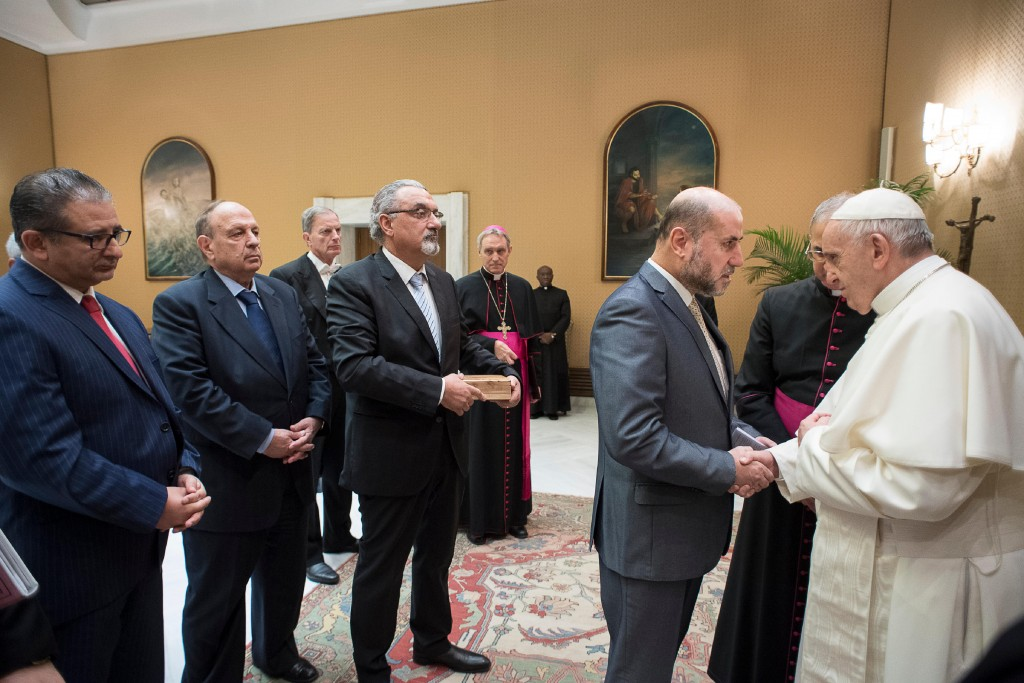 Pope Francis meets with a delegation of Palestinian religious and intellectual representatives, at the Vatican, Wednesday, Dec. 6, 2017. Pope Francis