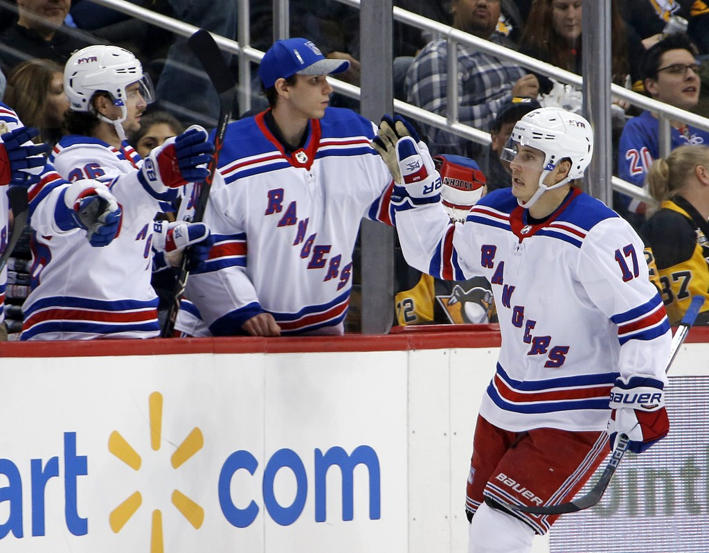 New York Rangers' Jesper Fast (17) returns to the bench after scoring during the second period of an NHL hockey game against the Pittsburgh Penguins i