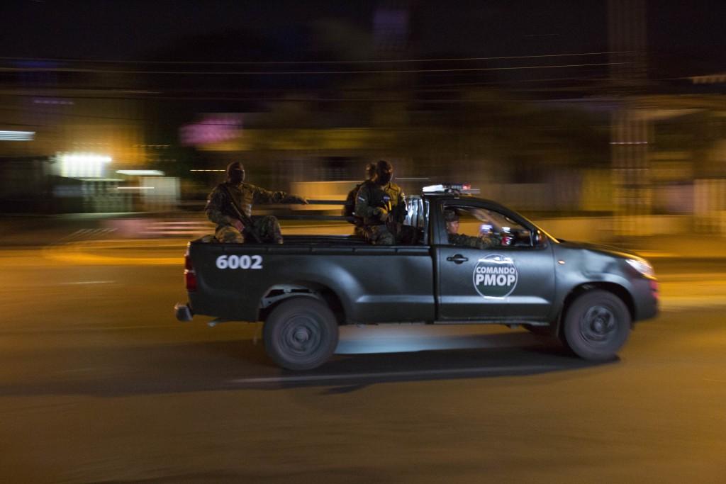 Soldiers patrol during a government imposed dawn-to-dusk curfew in Tegucigalpa, Honduras, late Tuesday, Dec. 5, 2017. Honduran President Juan Orlando