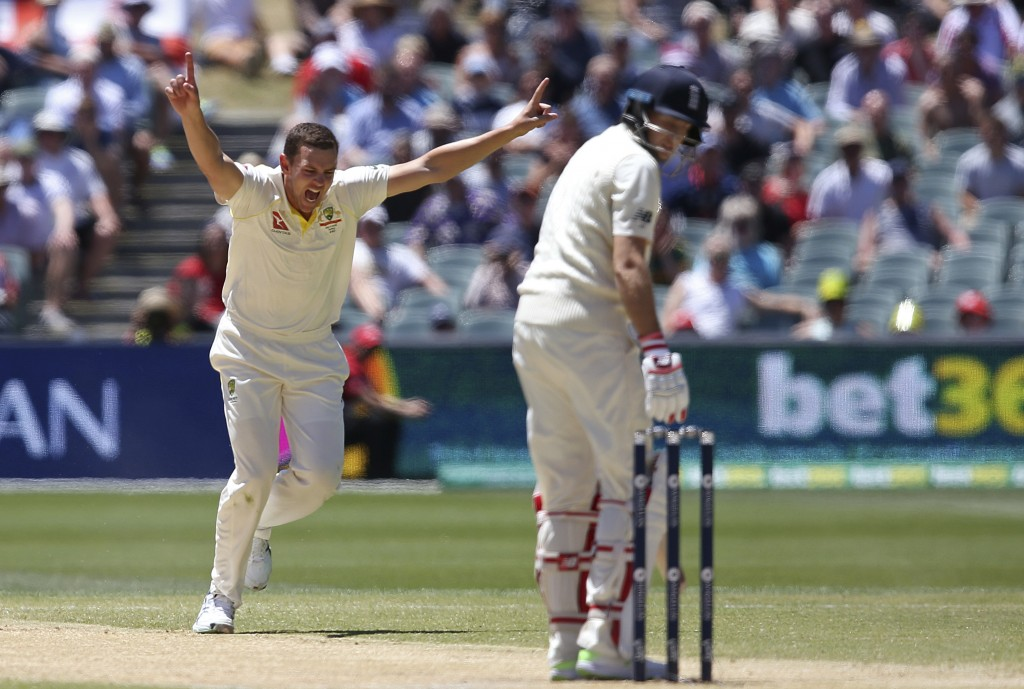 Australia's Josh Hazlewood, left, celebrates the wicket of England's Joe Root, right, caught behind for 67 runs during the fifth day of their Ashes cr
