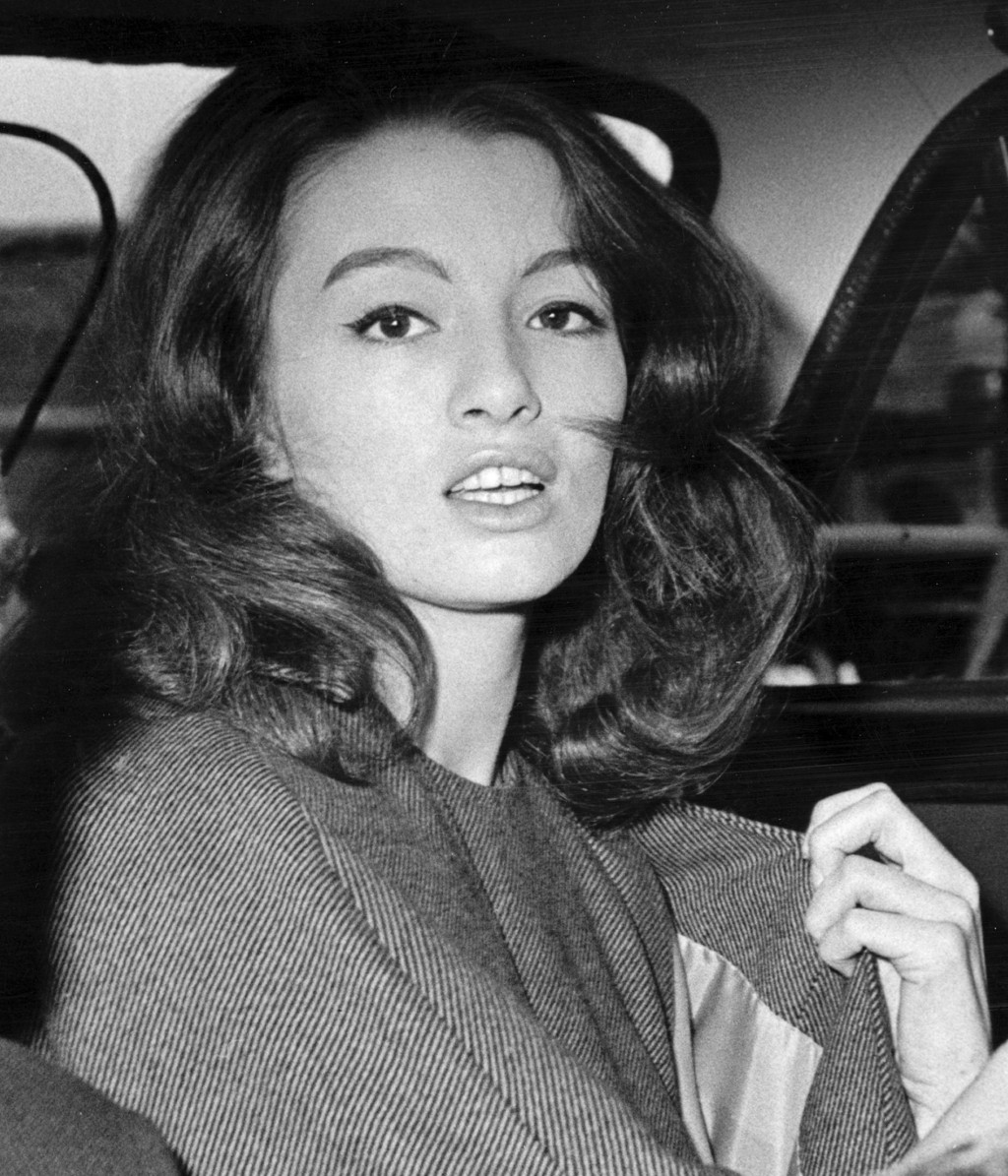 FILE - in this file photo dated  July 22, 1963 Christine Keeler, a principal witnesses in the vice charges case against osteopath Dr. Stephen Ward.  T