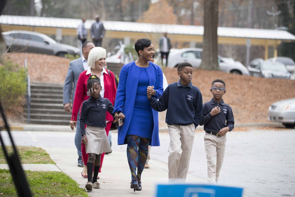 Atlanta mayoral candidate Keisha Lance Bottoms and her family prepare to enter the gym of Fickett Elementary School  to vote during the Atlanta mayora