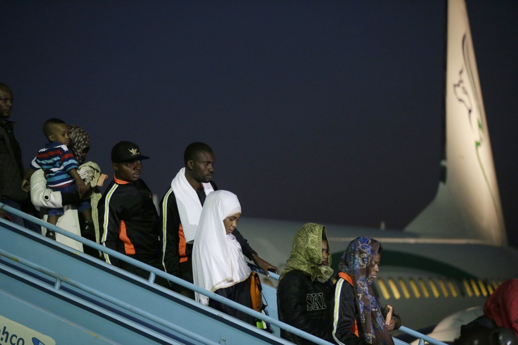 Nigerian returnees from Libya disembark from a plane upon arrival at the Murtala Muhammed International Airport in Lagos, Nigeria, Tuesday, Dec. 5, 20