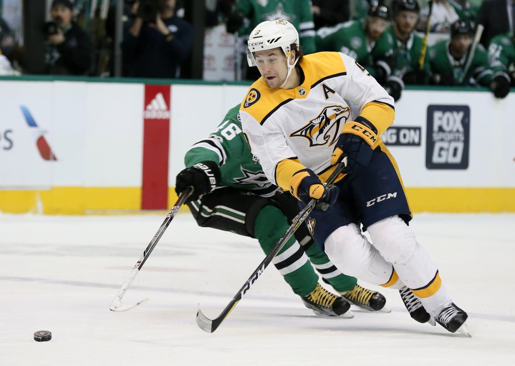 Nashville Predators left wing Filip Forsberg (9) of Sweden intercepts a pass intended for Dallas Stars center Gemel Smith (46) during the second perio