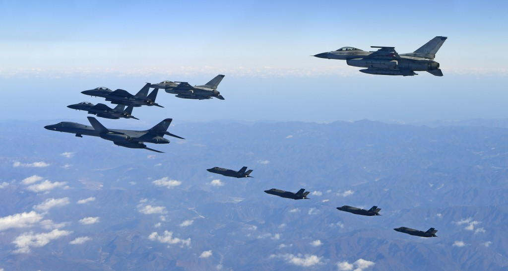 In this photo provided by South Korea Defense Ministry, U.S. Air Force B-1B bomber, far left, South Korea and U.S. fighter jets fly over the Korean Pe...