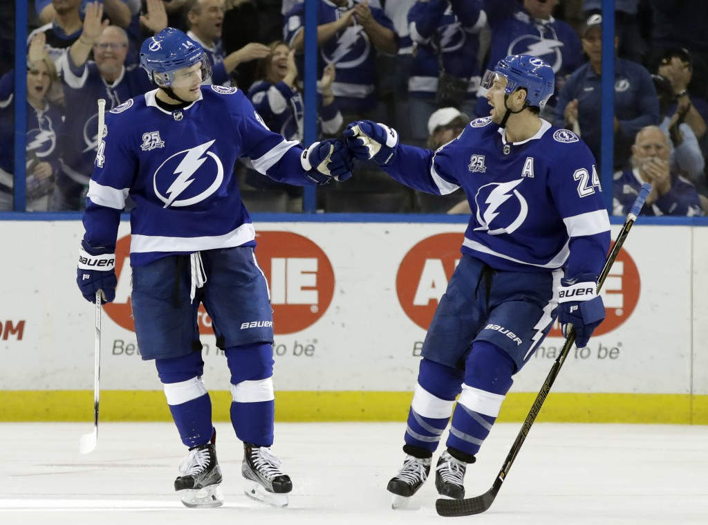 Tampa Bay Lightning left wing Chris Kunitz (14) celebrates his goal against the New York Islanders with right wing Ryan Callahan (24) during the third