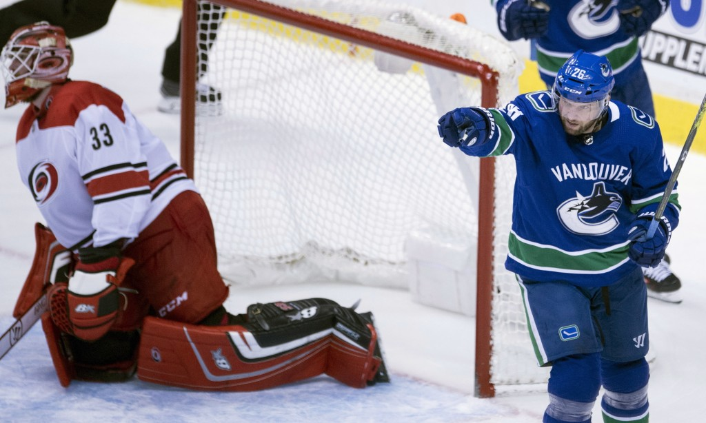 Vancouver Canucks left wing Thomas Vanek (26) celebrates his goal past Carolina Hurricanes goalie Scott Darling (33) during the second period of an NH