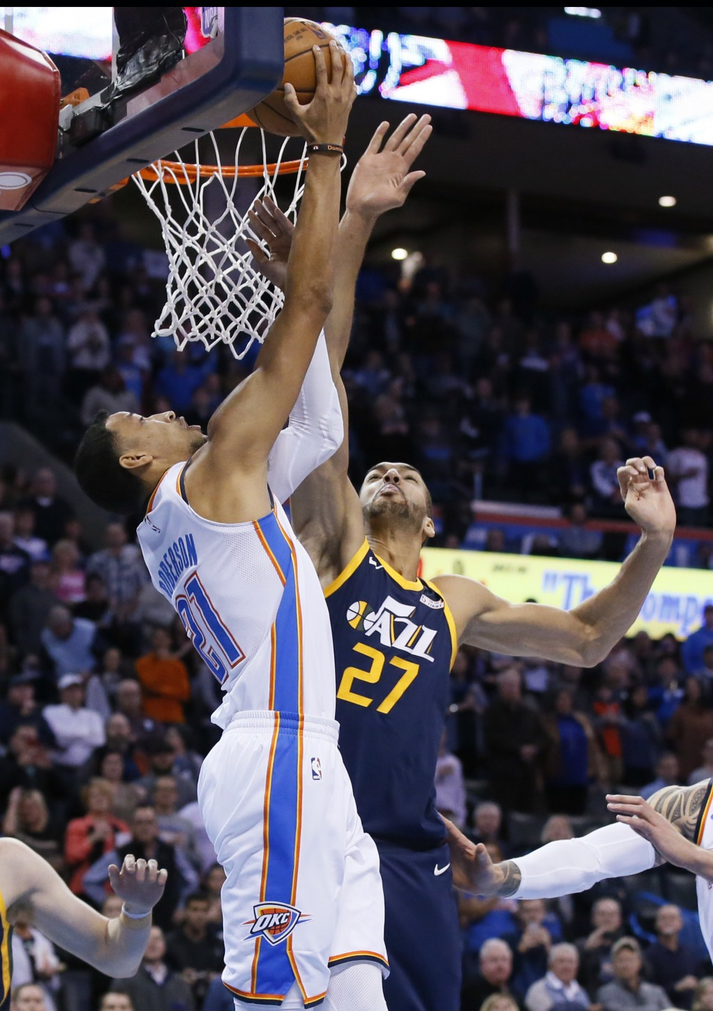 Oklahoma City Thunder guard Andre Roberson (21) shoots in front of Utah Jazz center Rudy Gobert (27) in the first quarter of an NBA basketball game in