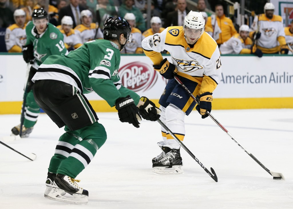 Dallas Stars defenseman John Klingberg (3) defends as Nashville Predators left wing Kevin Fiala (22) prepares to make a pass during the second period