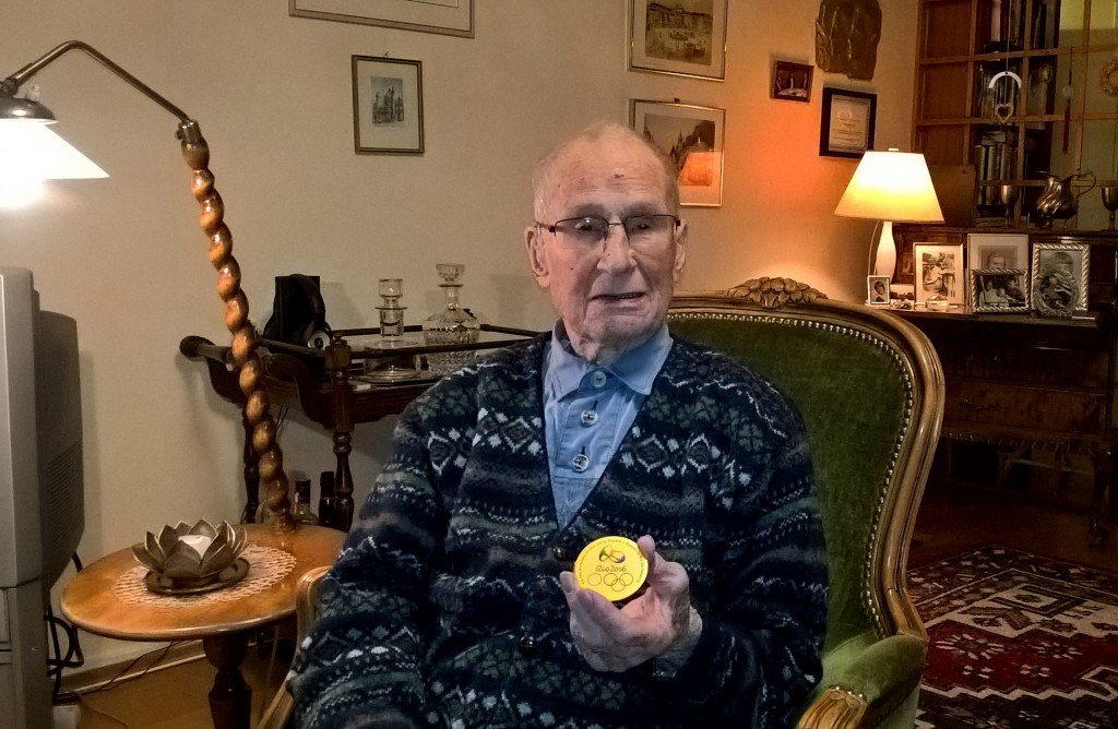 Finnish World War II veteran and Olympic athlete Torsten Liljeberg, aged 101, sits in his home in Helsinki, Finland on Friday Dec. 1, 2017, and shows