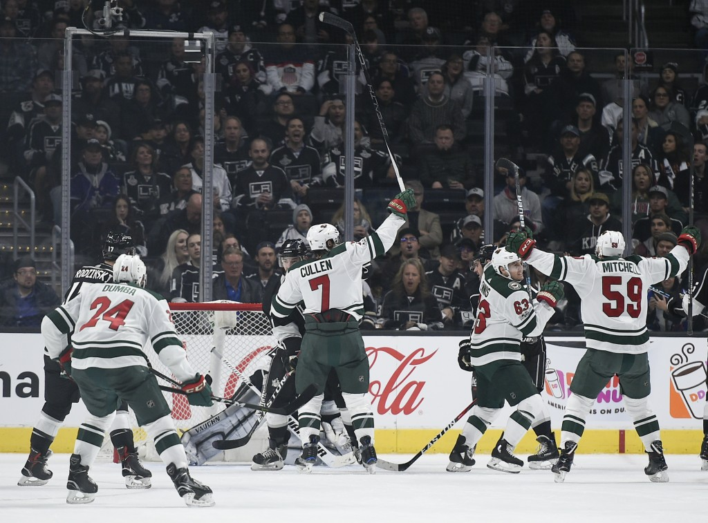 The Minnesota Wild celebrate a goal by left wing Tyler Ennis, second from right, during the second period of an NHL hockey game agains the Los Angeles