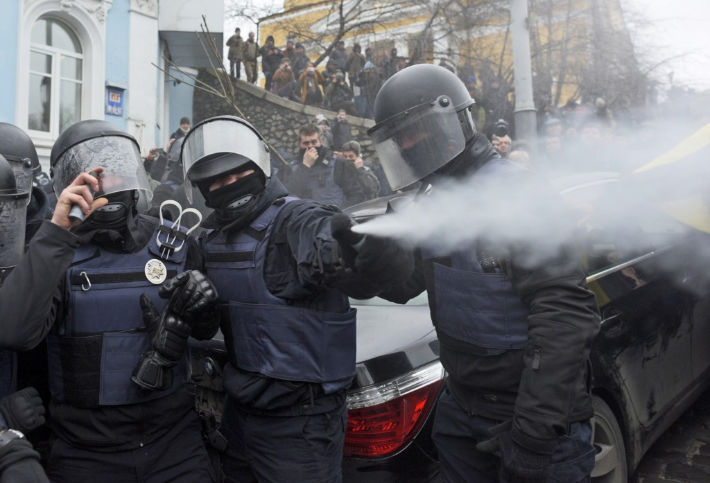 Police use tear gas as they clash with supporters of former Georgian president Mikheil Saakashvili in Kiev, Ukraine, Tuesday, Dec. 5, 2017. Hundreds o