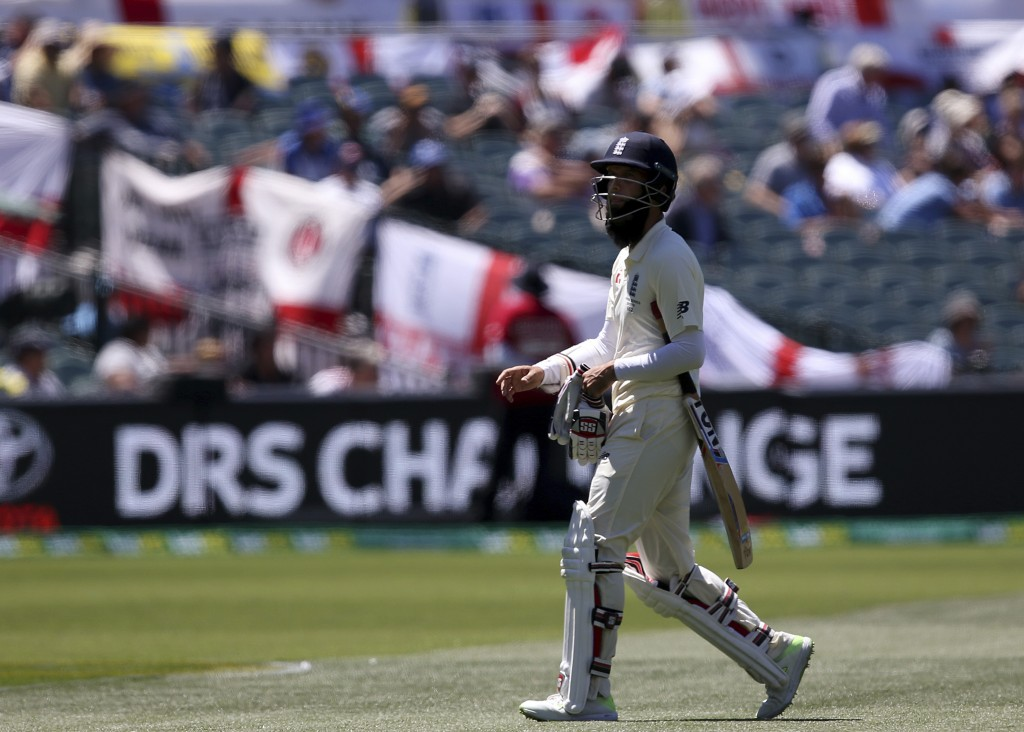 England's Moeen Ali walks off after he was given out LBW for 4 runs against Australia during the fifth day of their Ashes cricket test match in Adelai