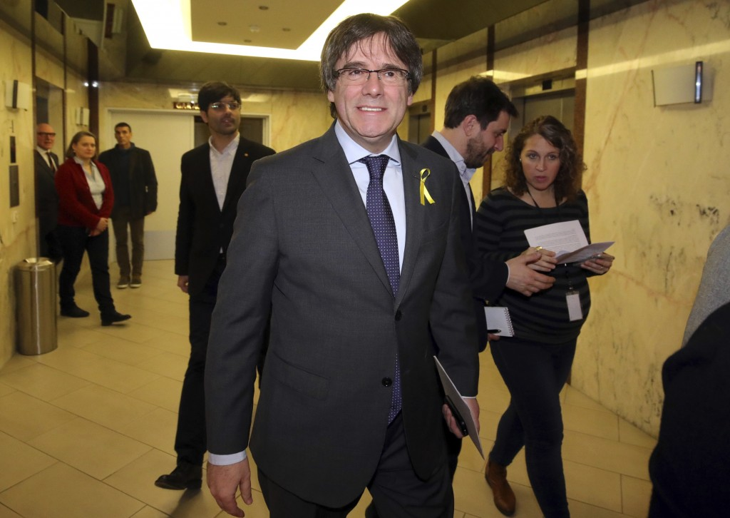 Ousted Catalan leader Carles Puigdemont arrives for a media conference in Brussels on Wednesday, Dec. 6, 2017. Catalan secessionist leader Carles Puig
